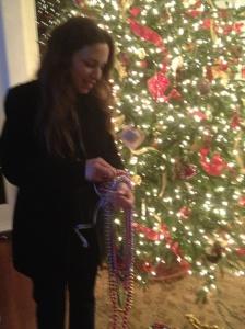 Allison Brunson sorting Mardi Gras beads