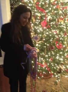Allison Brunson sorting Mardi Gras beads
