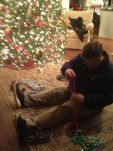 Richard Brunson sorting Mardi Gras beads